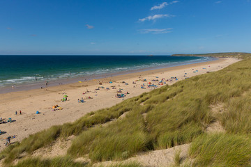Fototapete - St Ives Bay beach Cornwall uk in summer with people blue sky and sea, view towards Godrevy lighthouse