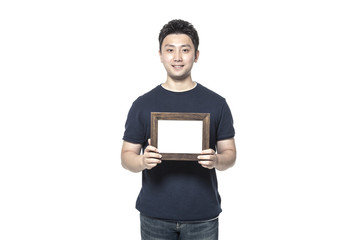 asian man hand hold a photo frame isolated white.