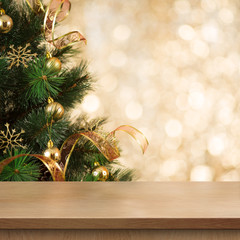 Christmas tree branch behind empty wood table or shelf