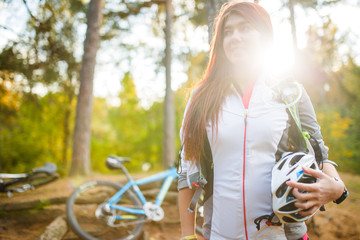 Image of young athlete with helmet on background of bicycle