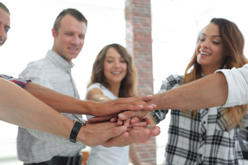 .friendly team of designers clasped their palms together