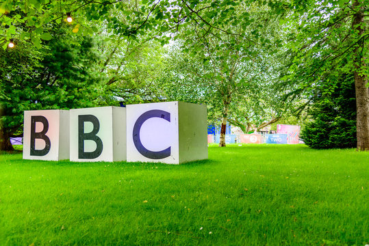large bbc sign in park with grass and trees