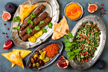 Middle Eastern traditional dinner. Authentic arab cuisine. Meze party food. Top view, flat lay, overhead