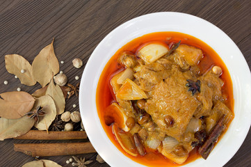 Mussaman curry chicken in white bowl with spices and herbs  / Halal food and selective focus..