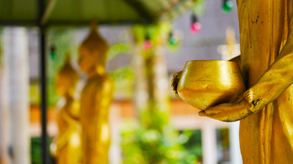 hand of golden buddha statue , hand on  almsbowl or monk's bowl