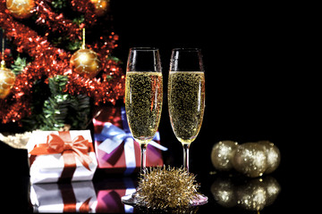 Champagne glasses  and gifts on  black background