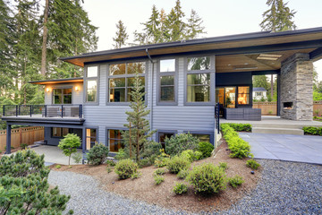New modern two-story home features backyard area