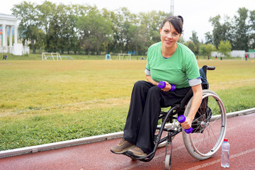 Disabled girl on a stadium