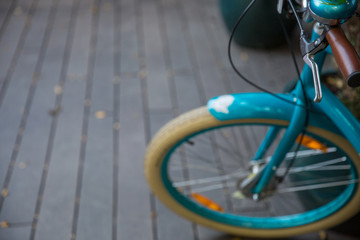Vintage Bicycle on the street. top view of the handle and wheel