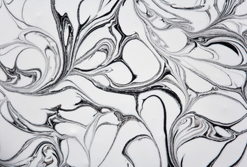 marble texture formed by mixing white  gray  paints, abstract background