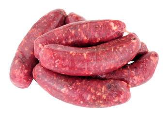 Raw venison meat sausages isolated on a white background