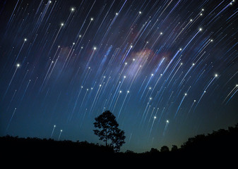 Rotating star galaxy mountain night blue sky tree