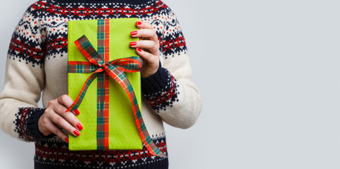 Unrecognizable woman holding christmas gift