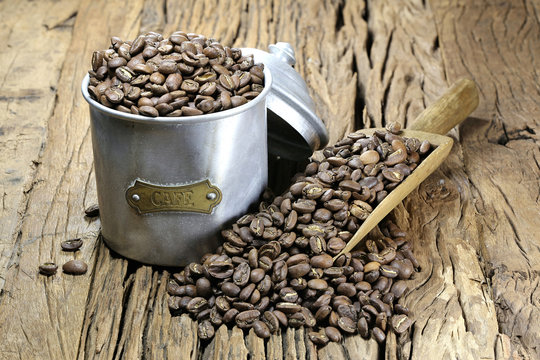 vintage French coffee can with manufacture roasted Indonesian Arabica coffee beans on rustic wooden background