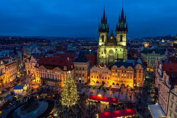 Old Town Square and Christmas market at evening in Prague.