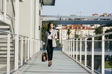 Elegant woman walking on street