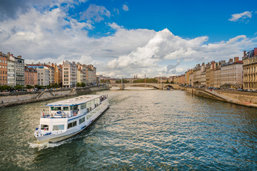 Boat moving down the Saone river in the city of Lyon, France