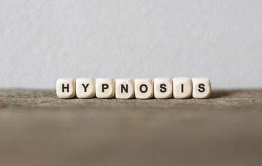 Word HYPNOSIS made with wood building blocks