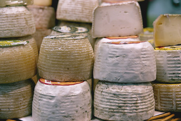 Display of delicious cheeses on a street market.