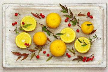 Yuzu - Japanese citrus fruit on the tray.