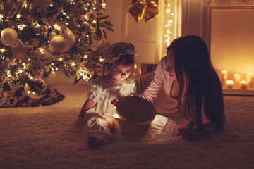 Beautiful woman with a baby in Christmas