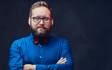 A man in eyeglasses and bow tie.