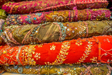 Close up of heap of cloth fabrics at a local market in India