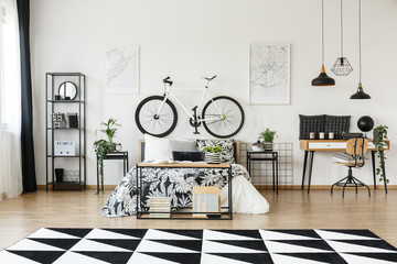 Desk and  bicycle in bedroom