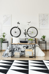 White bicycle in teenager's bedroom