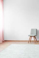 Grey chair in bright interior