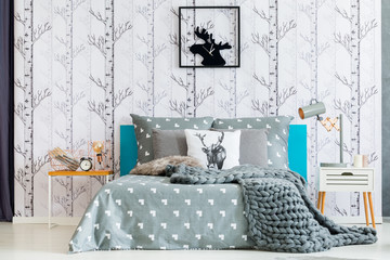 Moose clock in white bedroom