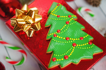 Christmas New Year holiday background. Gingerbread cookies, Christmas tree on white table. Top view