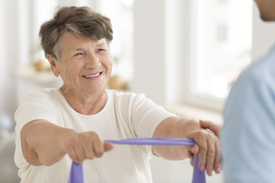 Senior woman with elastic tape