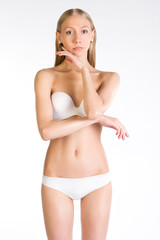 Beautiful slim girl on white background