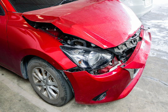 Front of red car get accident hit the damage until crash