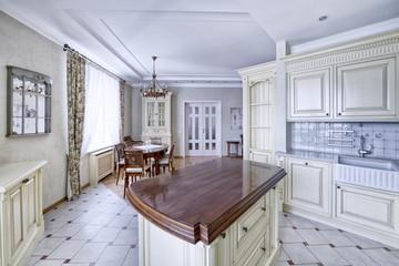 Modern design white kitchen in a spacious apartment.