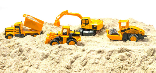 miniature Crawler Excavator on construction Working asphalt paver and truck with body. Heavy machine equipment for excavation works at civil industrial construction
