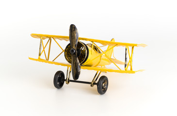 Vintage Yellow metal toy plane isolated on white