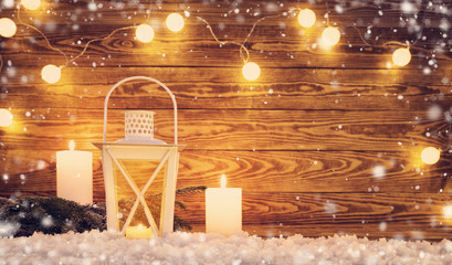 Old wooden planks with christmas decoration. Brown background with lantern and snow