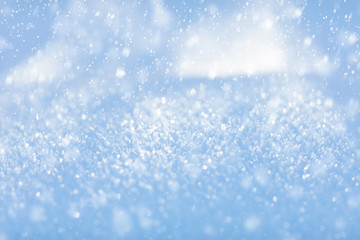 White snow. Sparkling snowflakes. Winter background. Close up.