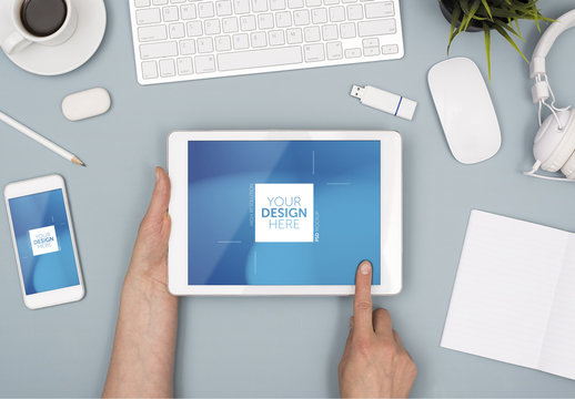Top View Mockup of Tablet User with Smartphone on Blue Desk