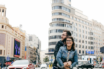 .A young couple in love walking around Madrid and enjoying a very fun day of sightseeing around the city center. Travel photography. Lifestyle