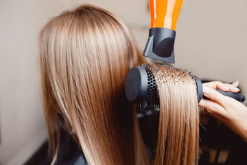 Close-up of hair dryer for hair drying, concept hair salon, female stylist.