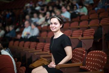 female in black dress at theatre