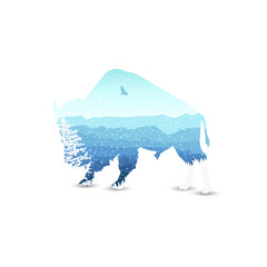 Fototapeta Silhouette of bizon with mountains  landscape and coniferous trees. Blue shades. Winter. Cold. Snowing.