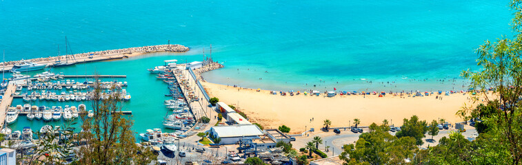 Waterfront with marina and beach in resort town Sidi Bou Said. Tunisia, North Africa