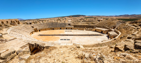 Ancient ruins of amphitheater in roman town Uthina (Oudhna). Tunisia, North Africa