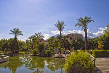 Palms and fountain in Kugulu park - Kemer, Turkey