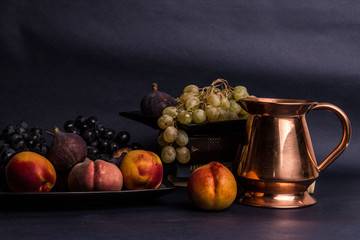 Still life art photography with books fruits on table