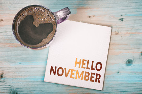 HELLO NOVEMBER note on a napkin with a cup of coffee